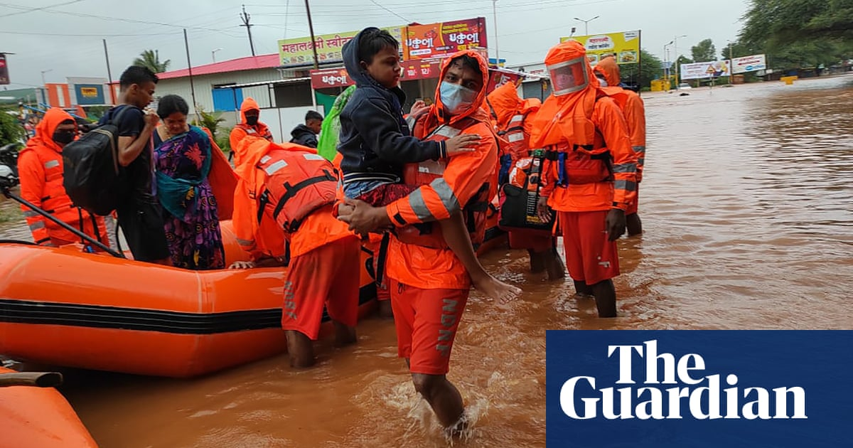 India floods: rescuers search for survivors among mud and debris