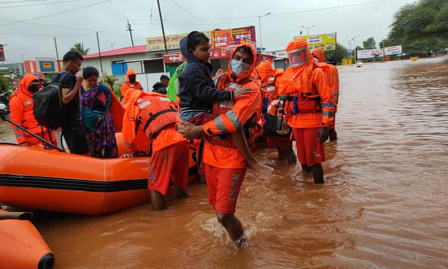 National disaster response force personnel rescue people in the Chiplun area in the western Indian state of Maharashtra on Friday