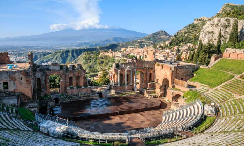 The Greek theatre at Taormina, with the town centre and Mount Etna behind.