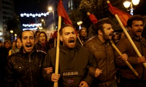 Protesters shout slogans during a demonstration against Obama's visit to Athens.