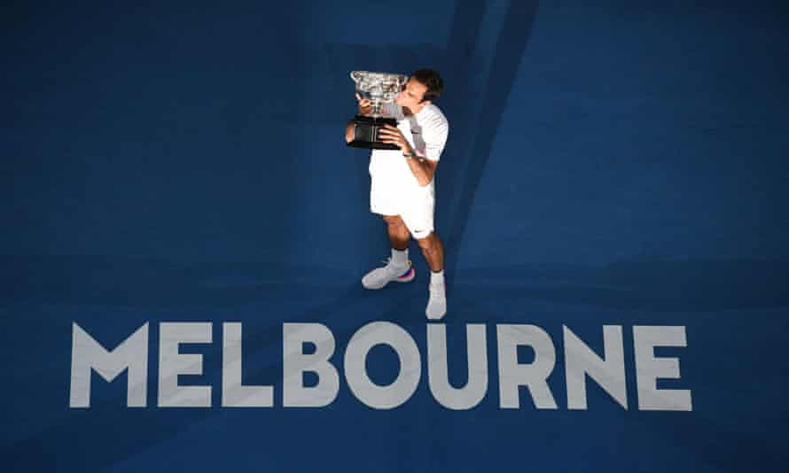 Roger Federer kisses the winner's trophy after beating Croatia's Marin Cilic.