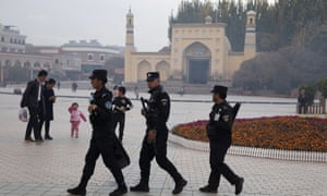 Uighur security personnel patrol near the Id Kah Mosque in Kashgar. Spending on security-related construction jumped 213% in 2017.