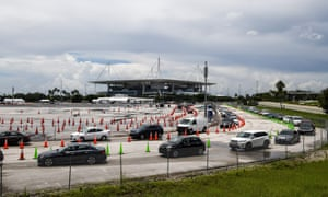 Cars line up at a rapid coronavirus testing site at Hard Rock Stadium in Miami Gardens near Miami.