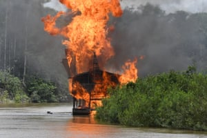 Brazilian soldiers destroy mining barges belonging to illegal gold miners in the Javari Valley