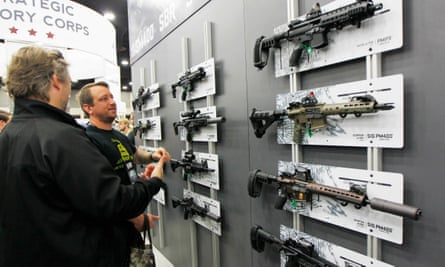 NRA gun enthusiasts view Sig Sauer rifles at the National Rifle Association's annual meetings & exhibits show in Louisville.