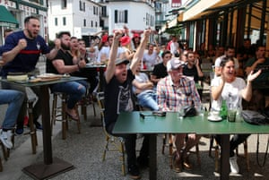 Supporters watching the game on a tv outside a bar in Saint Jean de Luz, southwestern France.