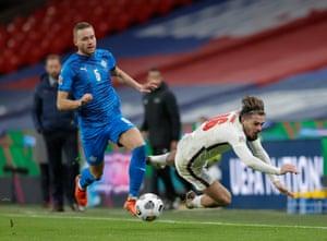 Sverrir Ingi Igason of Iceland is yellow carded after this foul on Jack Grealish.