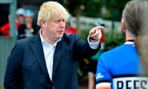 Boris Johnson talks to members of a local cycling clubin Beeston, on 28 Jul 2020.