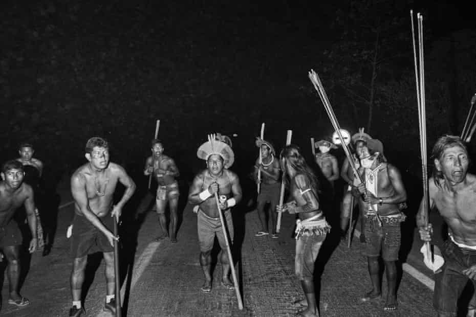 The Kayapo Mekragnotire Indigenous group blocks a highway near Novo Progresso, Para. Protesters blocked highway BR-163 to pressure President Bolsonaro to better shield them from Covid-19, to extend damages payments for road construction near their land, and to consult them on a proposed railway to transport soybeans and corn.