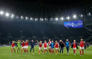 Arsenal players celebrate their 2-0 win.
