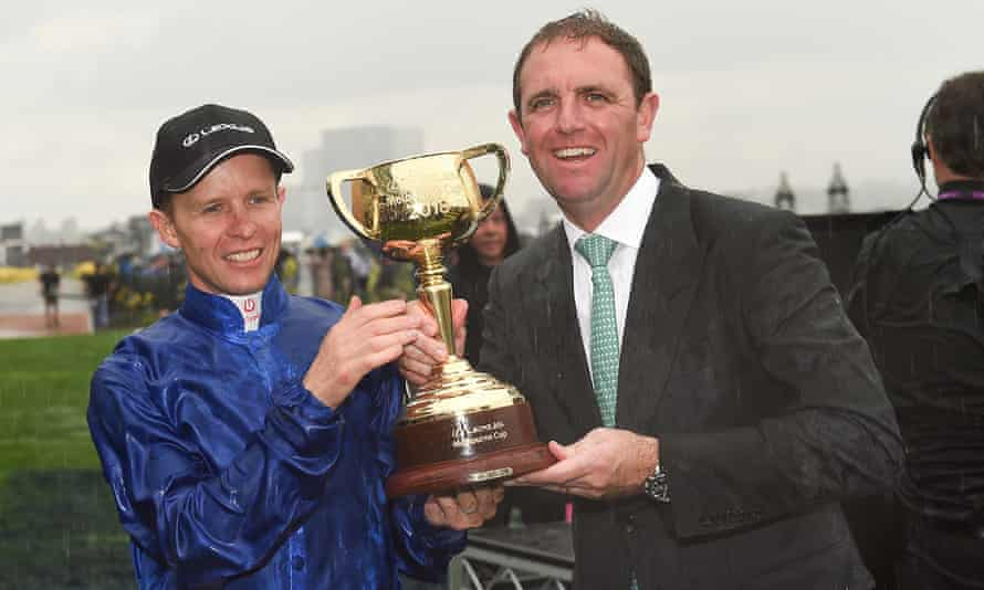 Jockey Kerrin McEvoy lifts the Melbourne Cup with trainer Charlie Appleby