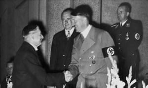 Neville Chamberlain shakes hands with Adolf Hitler eight days before signing the Munich agreement.