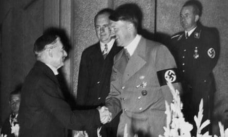 Adolf Hitler shakes hands with Neville Chamberlain  in Bad Godesberg