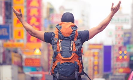 Tourist backpacker visiting a city in south-east Asia.