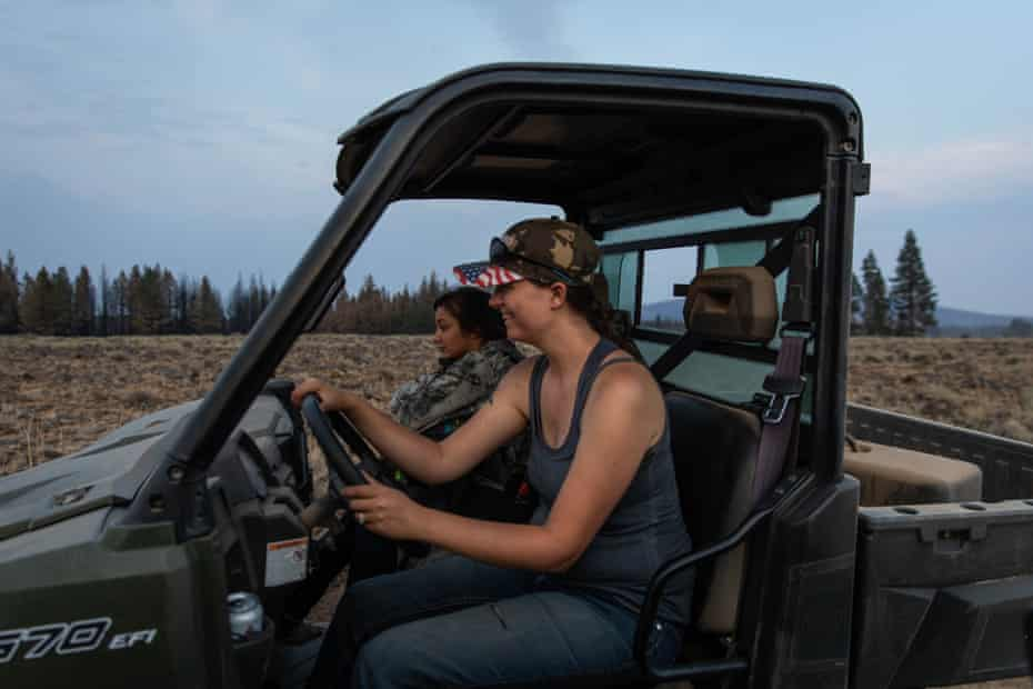 Valerie O'Dai drives an all-terrain vehicle to deliver water and supplies to residents affected by the Bootleg fire north of Bly, Oregon.