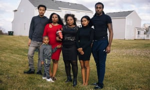 Carlene Veal and her family pose with the ashes of Walter Veal in University Park, Illinois. From left: Jordan Veal, Devohnte Harper Jr, Doreal Veal, Carlene Veal, Whitney Green and Carrice High.