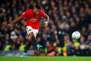 Manchester United's Marcus Rashford scores their second goal.