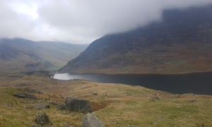 Lake Ogwen lies between the two mountain ranges of Snowdonia: the Carneddau and the Glyderau. Runners on the Dragon's Back mountain run pass by it.