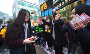 Students cheer in support as others arrive to sit the annual college entrance exam in Seoul.