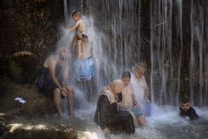 Beit Shean, Israel. Muslims stand under a waterfall during the Eid al-Adha holiday at the Gan HaShlosha national park