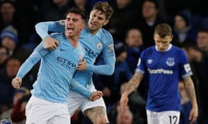Manchester City's Aymeric Laporte celebrates scoring their first goal with John Stones as Everton's Lucas Digne.
