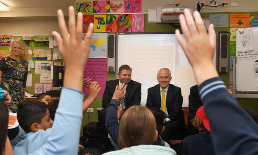 Malcolm Turnbull and Craig Laundy (centre left) with students at Strathfield North public school in Sydne