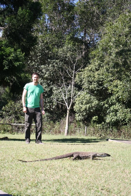 Nick Casewell and a goanna eye each other cautiously.