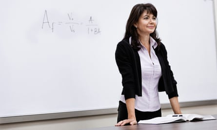 A lecturer standing in front of a whiteboard