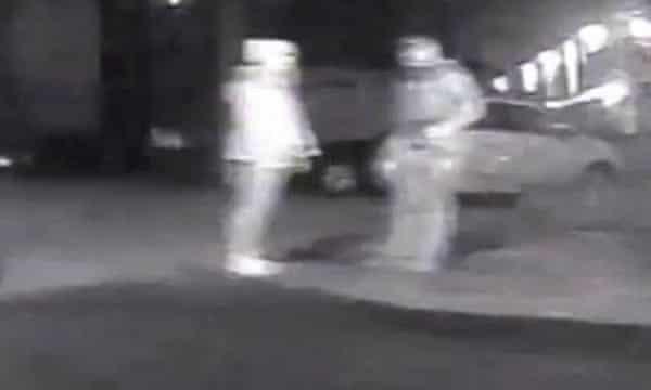 CCTV footage of Wayne Couzens and Sarah Everard beside a vehicle.