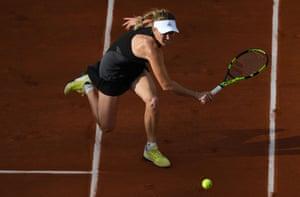 Wozniacki plays a backhand return to Garcia Perez.