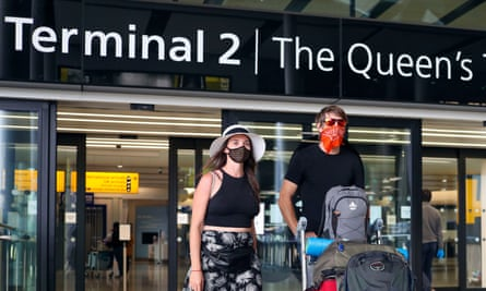 Passengers arriving at Heathrow airport in London.