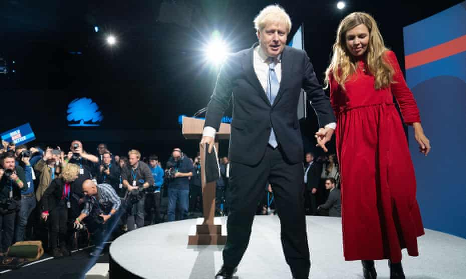 Boris Johnson is joined by his wife, Carrie, on stage after delivering his keynote speech at the Conservative party conference.