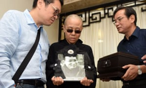 Liu Xia with a picture of her husband, Liu Xiaobo, who died in Chinese custody in July 2017.