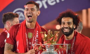 Dejan Lovren with Liverpool teammate Mohamed Salah at the Premier League trophy presentation at Anfield.