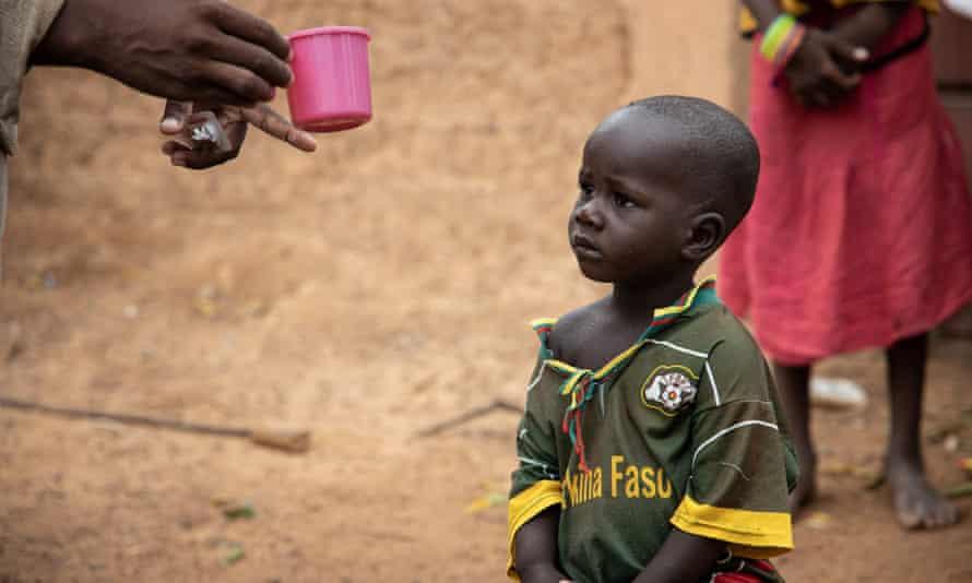 A child is given seasonal malaria chemoprevention in Goundri, north-east of Burkina Faso's capital Ouagadougou.