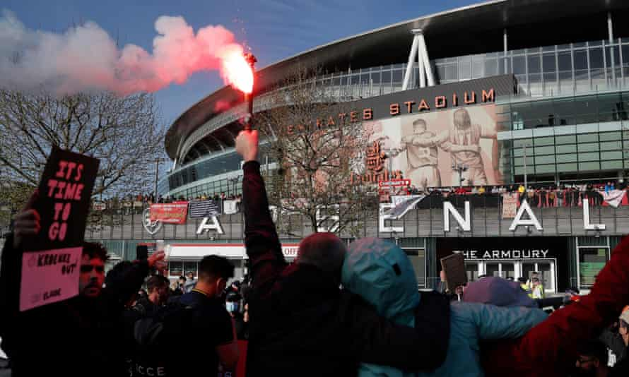 Arsenal fans gather outside the Emirates to protest against the ownership of the club