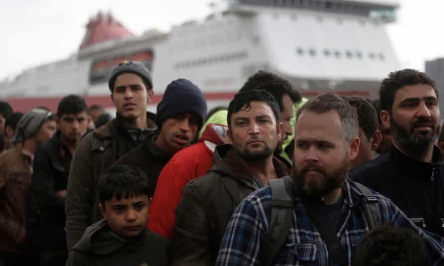 Refugees and migrants arrive at Piraeus near Athens