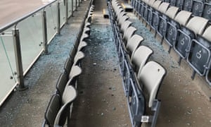 An area of level two seating is left covered in broken glass after a window fell from the floor above.