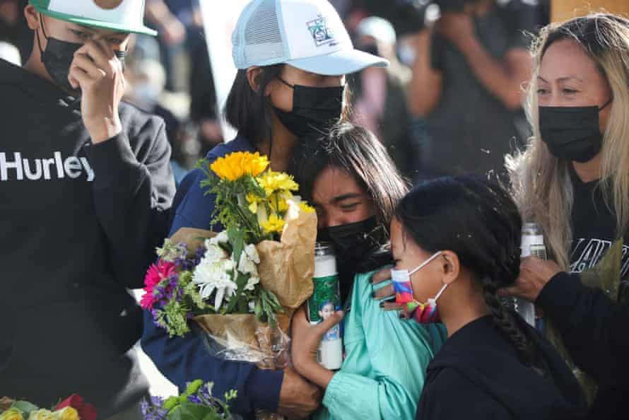 Paul Delacruz Megia's family members mourn during a vigil.