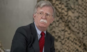 John Bolton attends a meeting with Donald Trump and senior military leaders at al-Asad airbase in Iraq on 26 December 2018.