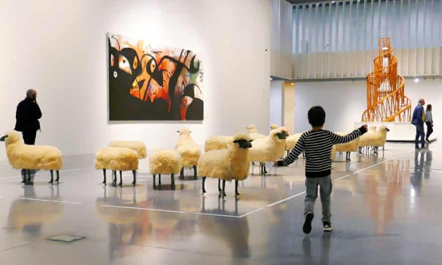 One of the writer's children skipping past François-Xavier Lalanne's flock of sheep at Malaga's Centre Pompidou.