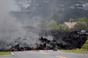 A man films the lava in the Leilani Estates subdivision