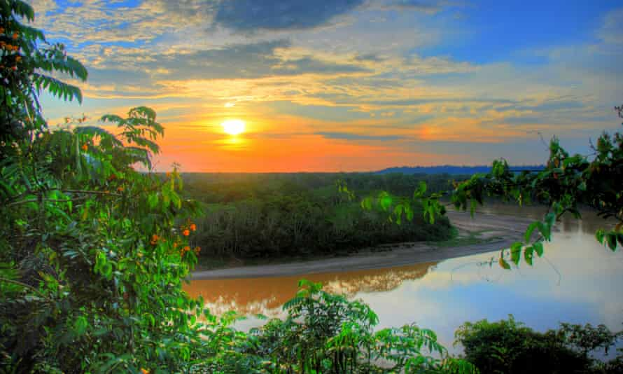 A high dynamic range photo of a sunset over the Amazon rainforest.