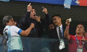 Diego Maradona gestures to the crowd during the game against Nigeria, which Argentina won 2-1 to qualify for the knockout stage of the World Cup.
