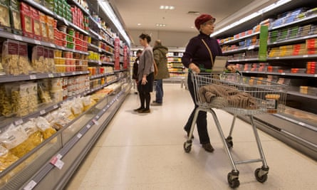 Shoppers browse the aisles in a Waitrose store.