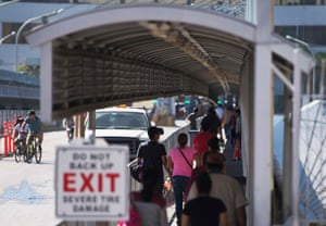 People cross the bridge on the US/Mexico border in Laredo
