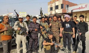 Iraqi security forces and tribal fighters pose for a photograph in central Ramadi, 70 miles (115km) west of Baghdad on Thursday.