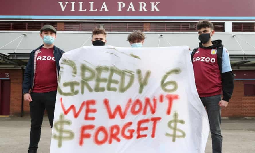 Aston Villa fans display a banner reacting to the collapse of the planned creation of a European Super League before their game with Manchester City on Wednesday.