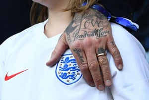Harper Beckham sings the national anthem when Father David has his hand on the England badge.