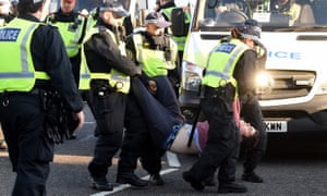 A man is arrested by police on Lambeth Bridge in London on Saturday 17 November – part of a protest organised by the Extinction Rebellion group